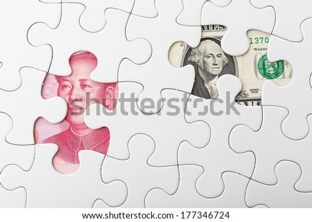 US and chinese yuan with white puzzle for exchange rate concept - stock photo
