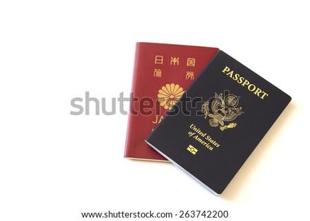 US and Japanese passport - stock photo