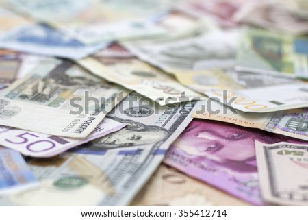 US and Swiss Currency and another Currencys - stock photo