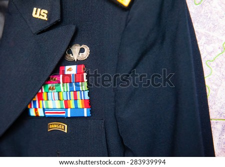 us army dress uniform in front of a map - stock photo