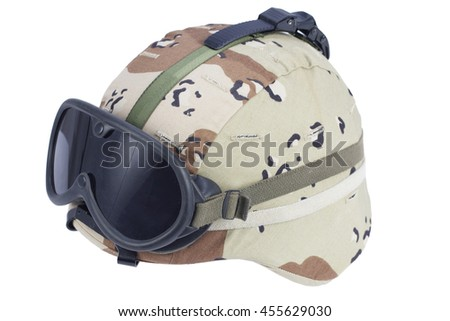us army kevlar helmet with a desert camouflage cover and protective goggles