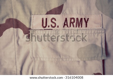 US Army patch on solder's uniform - stock photo