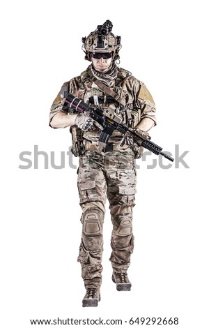US Army rangers in combat uniforms with his shirt sleeves rolled up, in helmet, eyewear and night vision goggles moving walking towards camera. Studio shot, white background