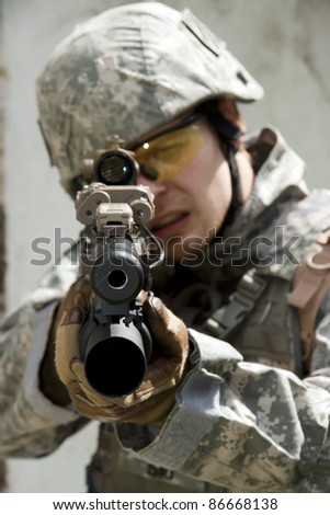 US Army Soldier in action aiming at you