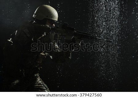 US Army soldier in the rain - stock photo