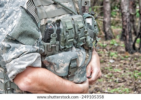 US Army soldier wearing his armor jacket - stock photo