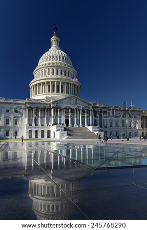 US Capitol Building and reflection over the glass roof - Washington DC, United States of America - stock photo
