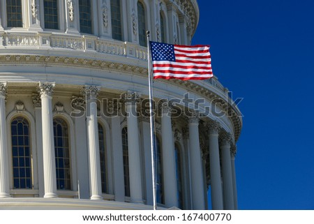 US Capitol building dome detail and waving American flag - Washington DC  - stock photo
