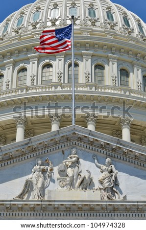 US Capitol Building east facade dome detail with flapping US flag - Washington DC - stock photo