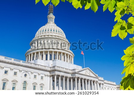 US Capitol over blue sky - stock photo