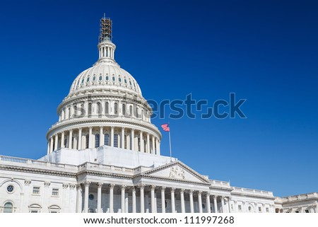 US Capitol over blue sky, Washington DC - stock photo