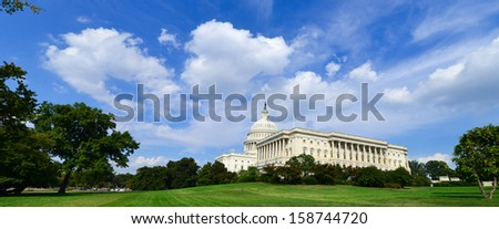US Capitol wide angle view in clouds - Washington DC, United States