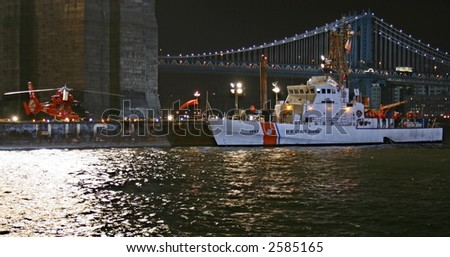 US Coast Guard Cutter and Helicopter in New York City at Night