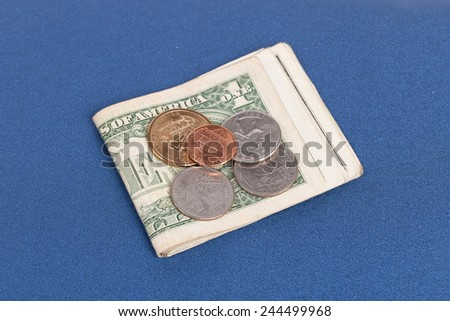 US coins on a blue notebook cover - stock photo