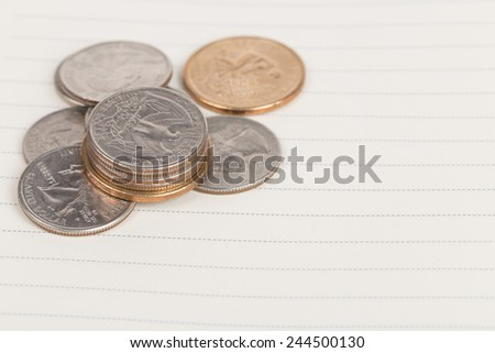 US coins on a notebook - stock photo
