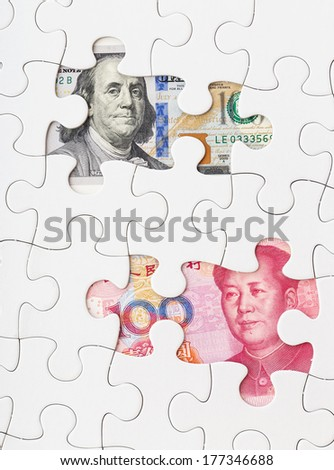 US dollar and chinese yuan with white puzzle - stock photo