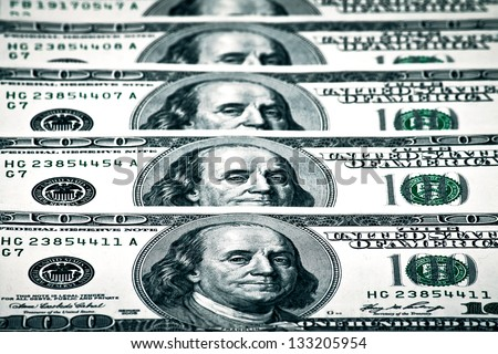 US Dollar and foreign currency representing economic crisis - stock photo
