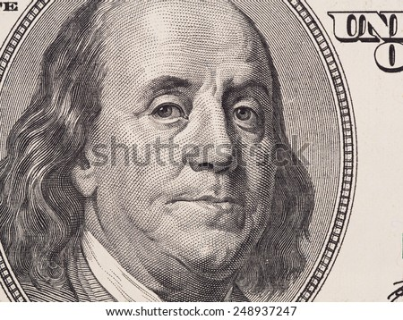 US 100 dollar bill fragment closeup, Benjamin Franklin face portrait, united states money