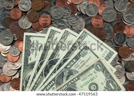 us dollar bills and change - stock photo