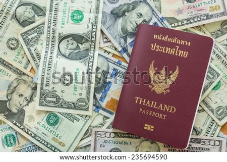 US dollar bills background passport - stock photo