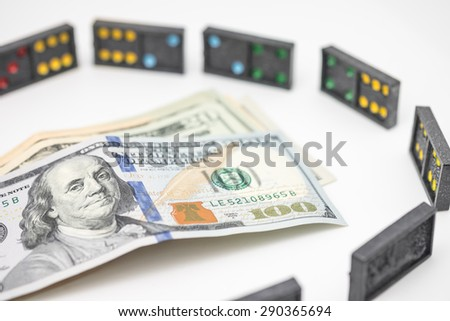 US dollar bills with domino as business or financial symptom background - stock photo