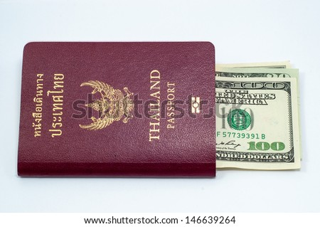 us dollar bills with Thailand passport on white background