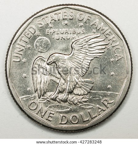 US Dollar Coin Reverse Featuring Eagle Landing on the Moon - stock photo