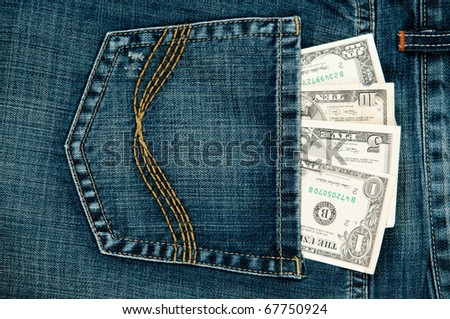 US dollar in the Jeans Pocket. - stock photo