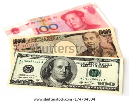 US dollar, Japanese yen and Chinese yuan bills - stock photo