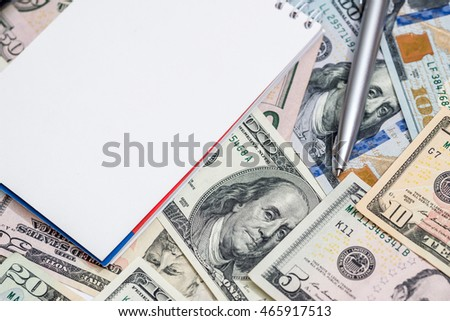 us dollar with pen and notepad