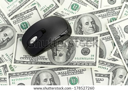 US Dollars and Computer Mouse - stock photo