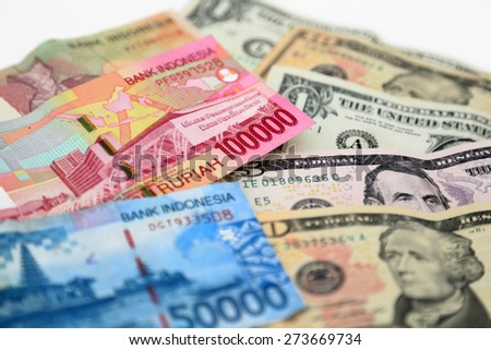 US Dollars and Indonesian Rupia  - stock photo
