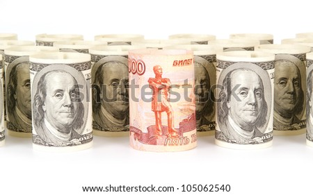 US dollars and Russian roubles banknotes - stock photo