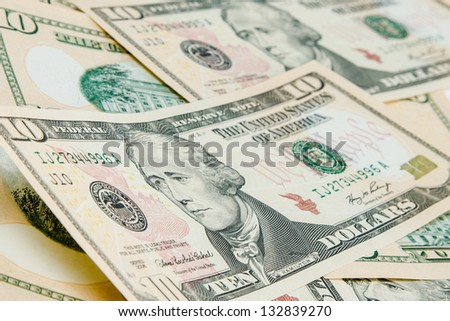 US Dollars background with focus on Alexander Hamilton - stock photo