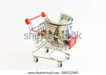 US dollars banknote in shopping cart isolated on white background. Concept of currency, business, finance and online shopping/e-commerce.