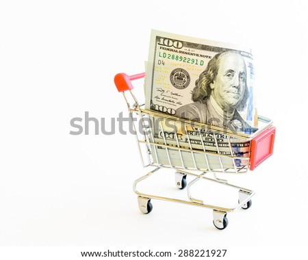US dollars banknote with shopping cart isolated on white background. Concept of currency, business, finance and online shopping/e-commerce. Copy space.