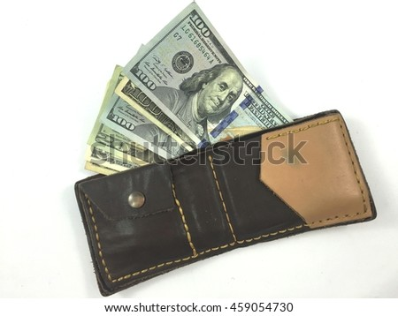 Us dollars bills in leather wallet - stock photo