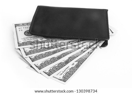 US dollars in a black wallet isolated on white