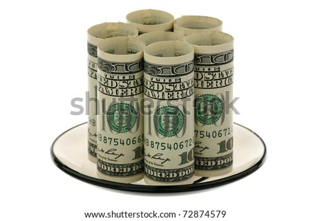 US dollars on a glass saucer on a white background