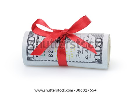 us dollars rolled and tied with red ribbon, isolated on white - stock photo