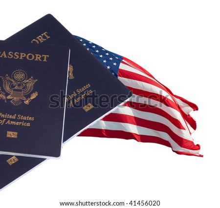 US flag and three US passports on white isolated - stock photo