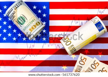 US flag. European community flag. Chart of euro dollar prices. Hundred us dollar bill, rolled. Rolled two hundred euro bill and several fifty euro bills. Concept of currency exchange trading.
