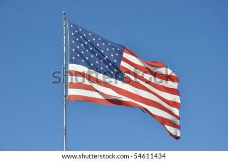 Us flag in front of blue sky