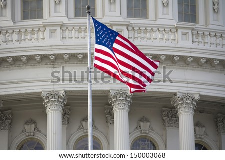 US flag on Capitol Building Dome Background, Washington, DC, USA.