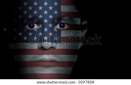 US flag painted/projected onto a man's face. - stock photo