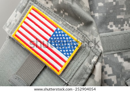US flag shoulder patch on solder's uniform - studio shot - stock photo