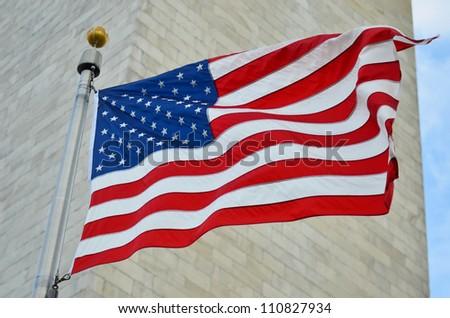 US flag waving with Washington Monument background in Washington DC - United States - stock photo