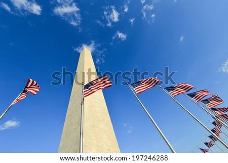 US flags encircling - Washington Monument - Washington D.C. United States - stock photo