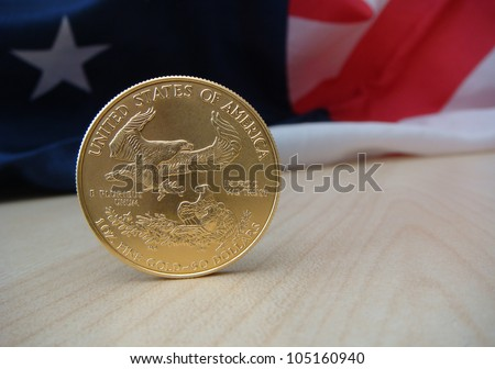 US $50 Gold Eagle Reverse Standing with US Flag, One Star Showing, in Back Ground - stock photo
