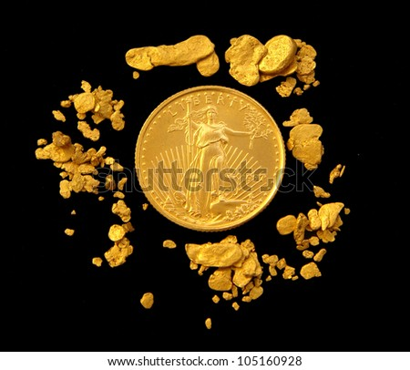 US Gold Eagle Surrounded by Natural Gold Nuggets - stock photo